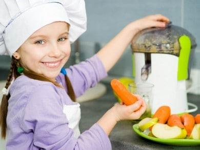 kid using a juicer